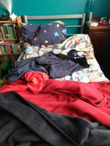 An image of an unmade child's bed.