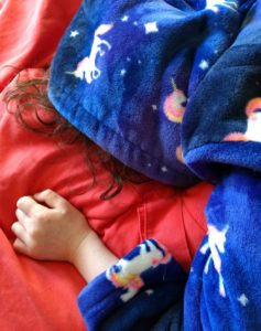 A picture of a sleeping child.