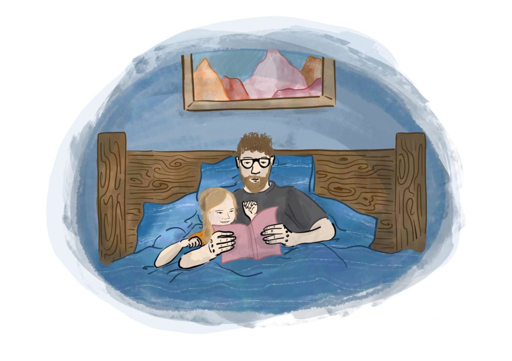 A picture from the book of a Dad reading to his daughter while they are snuggled up in bed.
