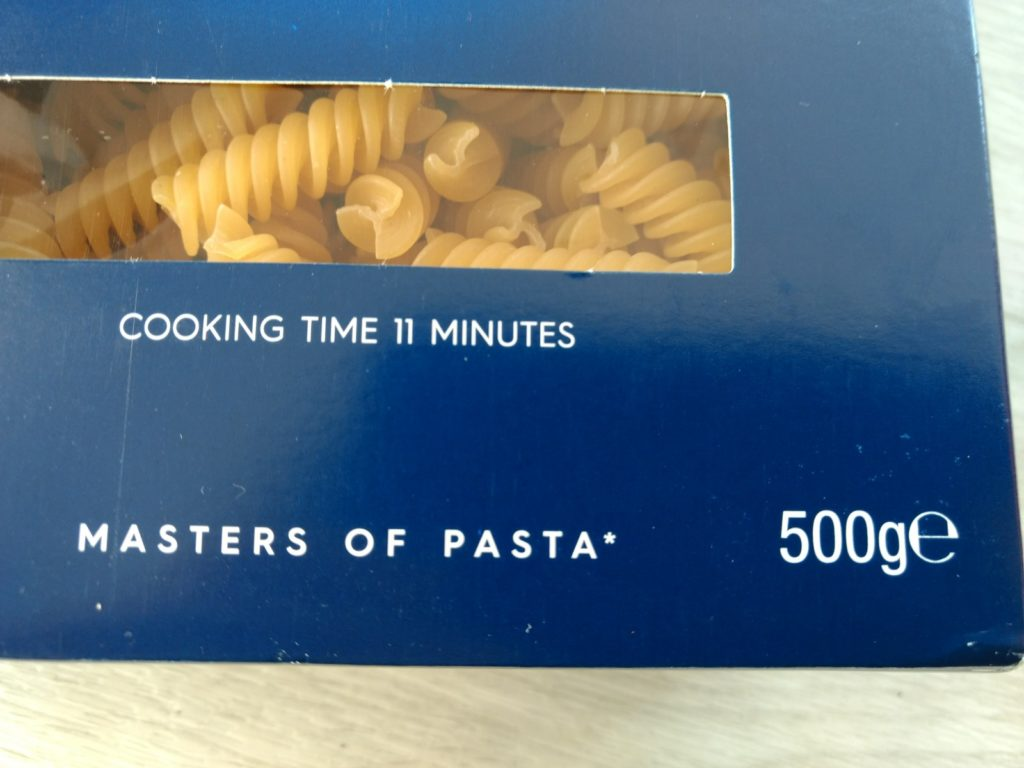 Image of a packet of pasta showing the weight and cooking time.