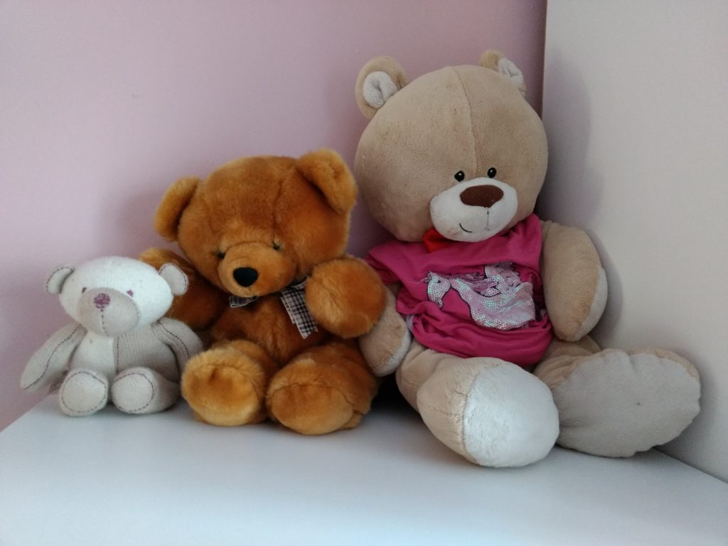 3 teddies are sitting together in order of size, smallest to biggest.
