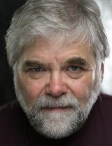 A headshot of Clive Osborne.