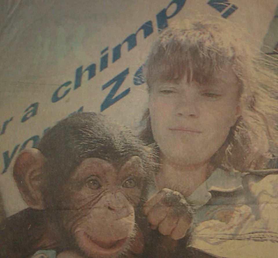 Teenaged Charl Baillie holds a young chimpanzee.