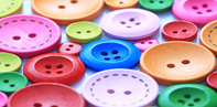 Image shows a close up of some colourful buttons.