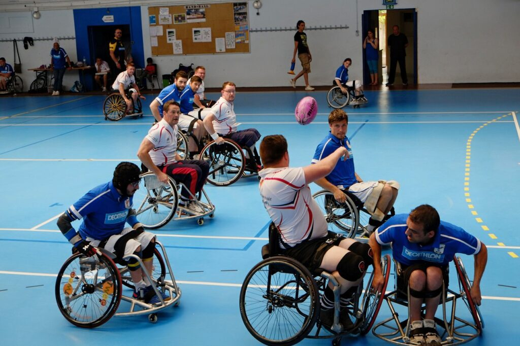 Image shows a group of people playing wheelchair rugby.
